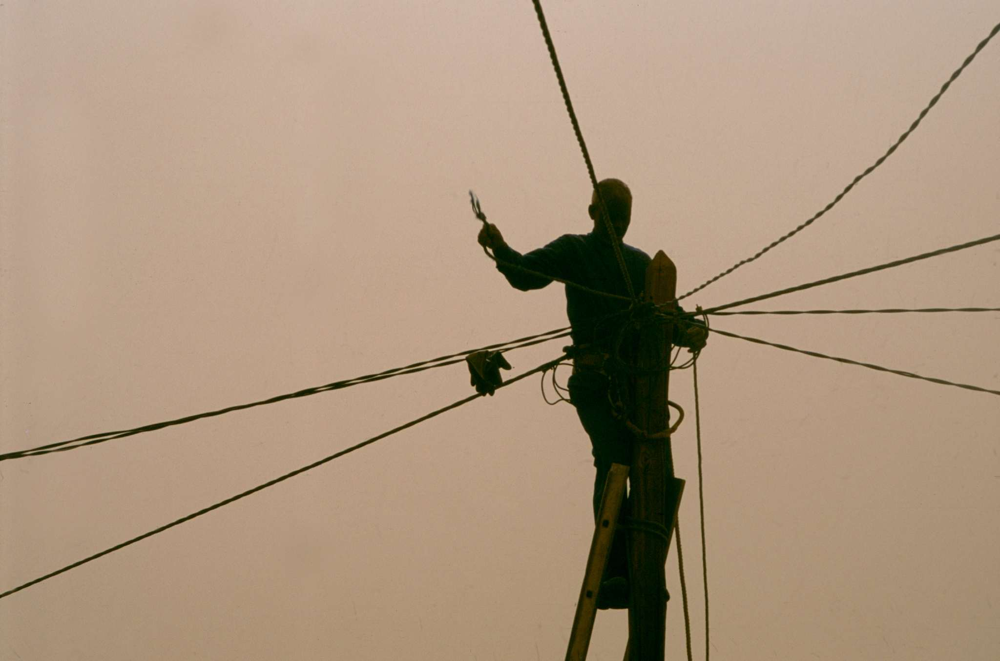 Man on ladder in power lines in Agadez