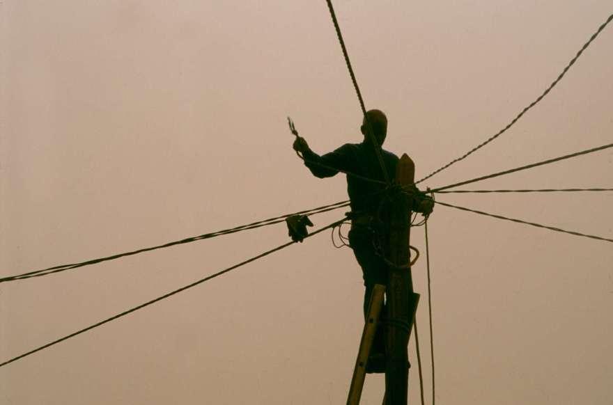 Man on ladder in power lines in Agadez